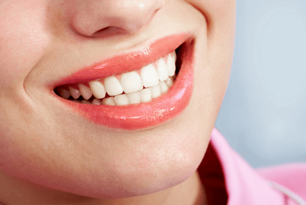 close up of woman's mouth, smiling